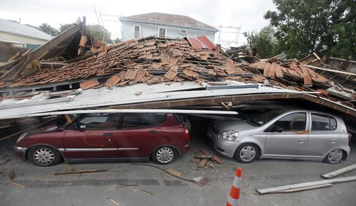 Cars lie crushed under a fallen building in central Christchurch, New Zealand, following a magnitude 6.3 earthquake (AP Photo/Mark Baker, Pool, File)