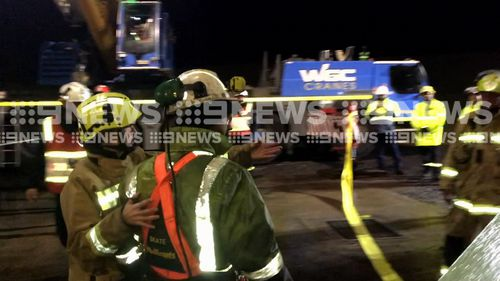The two miners were trapped for nine hours, finally being freed about midnight last night. (9NEWS)