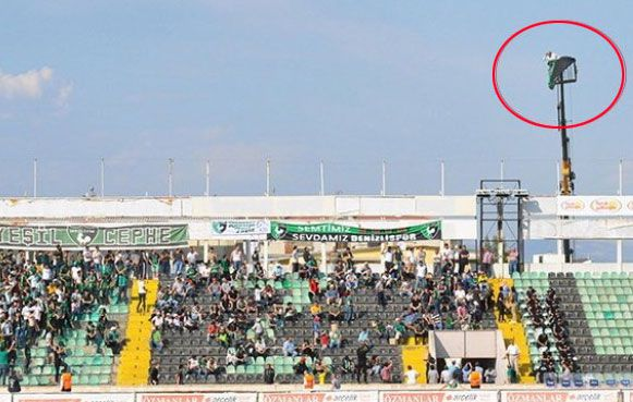 Banned football fan hires crane to watch team play