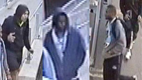 Police hunt three men over Sydney train station robbery