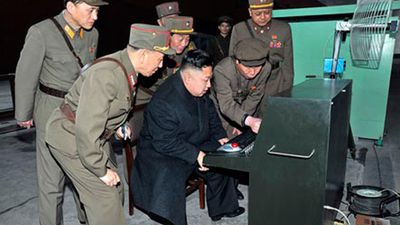 <p><b>Kim Jong Un: Weapons Expert</b></p>Kim Jong Un claims to have a magic weapon. He is pictured with it here, with what looks like a big, red button. (Supplied)
