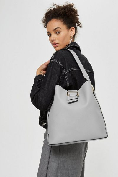 "<a href=""http://www.topshop.com/en/tsuk/category/stores-in-australia-4935086/home"" target=""_blank"" draggable=""false"">Topshop Seema Buckle Hobo Bag, $63</a>"