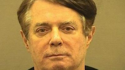 Judge drops some charges against Manafort