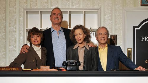Actors Connie Booth, John Cleese, Andrew Sachs and Prunella Scales pose for photographs as the original cast members of the British comedy programme 'Fawlty Towers' attend a media conference in 2009. (AFP)