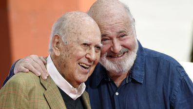 In this April 7, 2017 file photo, Carl Reiner, left, and his son Rob Reiner pose together following their hand and footprint ceremony at the TCL Chinese Theatre in Los Angele