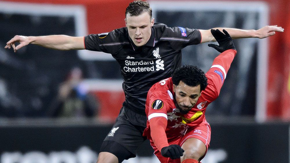 Liverpool's Australian defender Brad Smith (L) and Sion's Portugese midfielder Carlitos vie for the ball. (AFP)