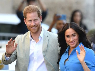 Prince Harry and Meghan Markle waving to crowd at public event