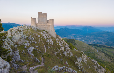 Santo Stefano di Sessanio, Italy. The ruins of Rocca Calascio, old medieval village with castle and church, 1400 meters above sea level on Apennine mountains, heart of Abruzzo region. Here in particular the ruins of fortress at sunset