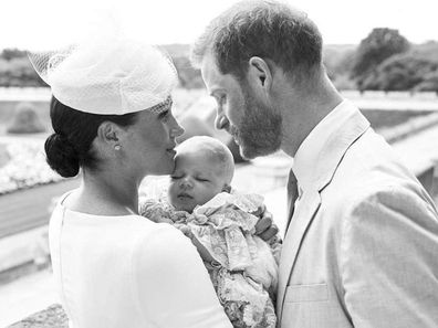 Meghan and Harry cradling Archie at his christening.