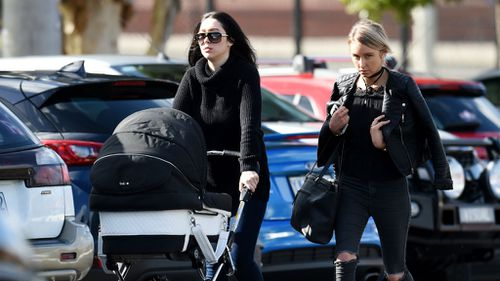 Danielle Stephens (left), the daughter of Roberta Williams, arrives at the funeral at Saint Therese's Parish earlier today. (AAP)