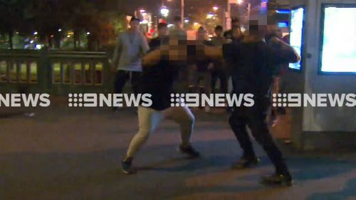 Two police officers suffered minor injuries during the riots. (9NEWS)