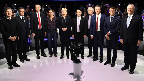 Francois Fillon (second from left) with the other French presidential candidates. (AAP)