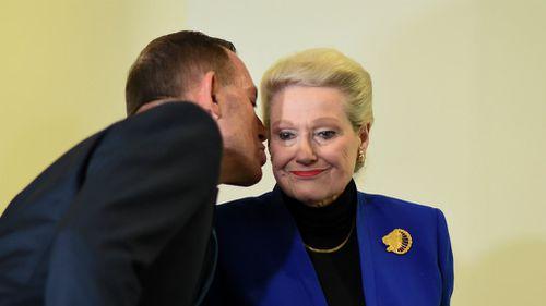 Tony Abbott leans in to kiss former Speaker Bronwyn Bishop. (AAP)