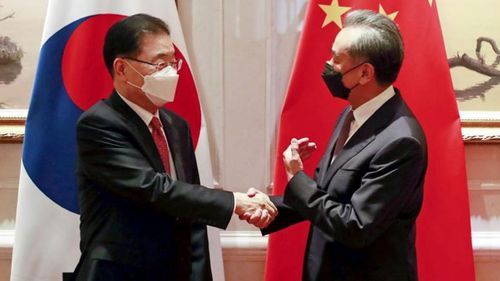 South Korean Foreign Minister Chung Eui-yong, left, shakes hands with Chinese Foreign Minister Wang Yi before their meeting in Xiamen, China, Saturday, April 3, 2021