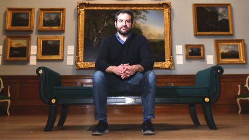 US artist Doug Fishbone poses in the Dulwich Picture Gallery in London. (AFP)