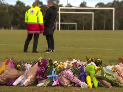 Flowers at the park where Eurydice was allegedly raped and murdered last week. (9News)