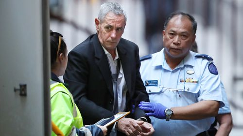Wayne Beattie is taken into the Victorian Supreme Court in Melbourne, Wednesday, March 10, 2020.