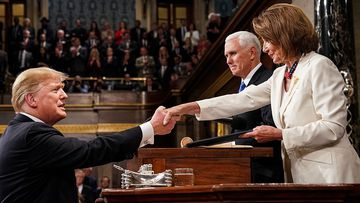 US President Donald J Trump (L) shakes hands with Vice President Mike Pence (C) and Speaker of the House Nancy Pelosi.
