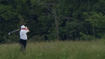 US. President Donald Trump swings a golf club during a round of golf, amid the COVID-19 outbreak, in Sterling, Virginia, U.S., May 24, 2020. Photo by Tom Brenner