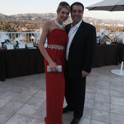 Mr Mirzikinian with his wife Kristy. (Facebook)