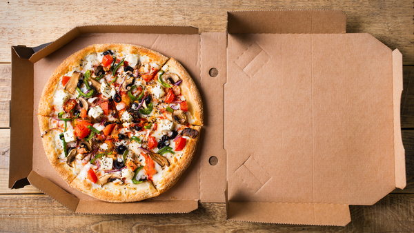 Stock image of pizza in a takeaway box