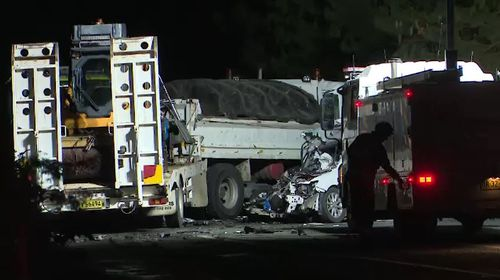 The driver of a suspected stolen taxi was killed when he crashed the vehicle into a truck on the Bells Line of Road at Bilpin, west of Sydney. Picture: 9NEWS.