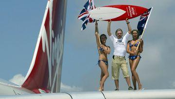Happier days: Sir Richard Branson, Chairman of Virgin Atlantic Airways pictured arriving at Sydney International Airport with the first Virgin Atlantic flight to Australia, in 2004.