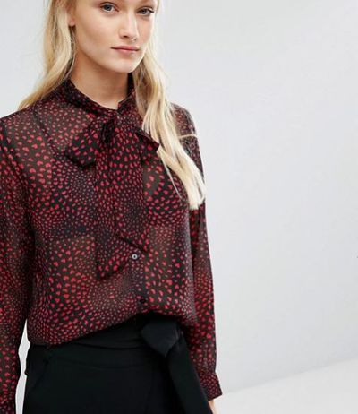 """Newlily pussy-bow blouse in heart print, $140.08, <a href=""""http://www.asos.com/new-lily/newlily-pussy-bow-blouse-in-heart-print/prd/7300540?iid=7300540&amp;clr=Redblack&amp;SearchQuery=pussy%20bow&amp;pgesize=21&amp;pge=0&amp;totalstyles=21&amp;gridsize=3&amp;gridrow=1&amp;gridcolumn=2"""" target=""""_blank"""">Asos.com.au</a><br />"""