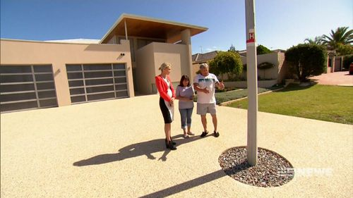 Antonio and Nancy Grasso say the lamp post is a hazard. (9NEWS)