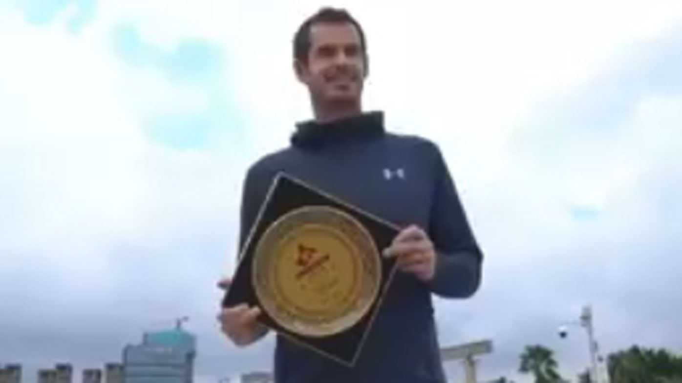 Scottish tennis player Andy Murray breaks commemorative plate before Shenzhen Open