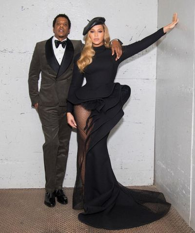 <p>Beyonce and Jay  Z at a Pre- Grammy Awards celebration in January 2018. </p> <p> Bey donned a custom asymmetrical gown with a long mesh train from Azzi & Osta, paired with the must-have accessory of the moment- A black leather beret. Jay – Z opted for a stone-grey corduroy tuxedo by Musika Frère, complete with a bow-tie.<br> <br> <br> </p>