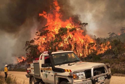 Fire crews are focusing on two major bushfires, with more than 30 still raging.