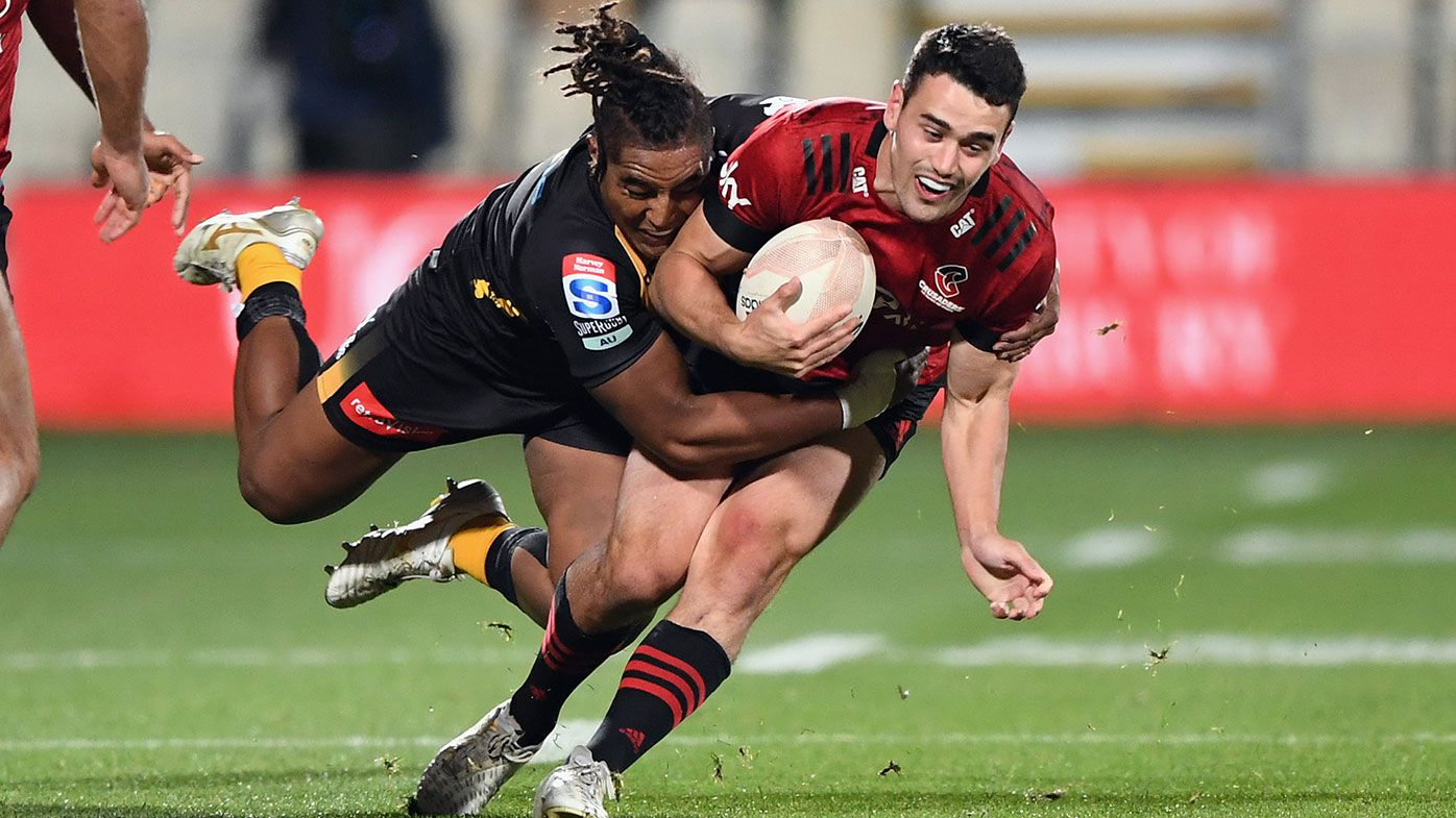 Will Jordan of the Crusaders is tackled by Feleti Kaitu'u of the Force during the round four Super Rugby Trans-Tasman match between the Crusaders and the Western Force at Orangetheory Stadium on June 04, 2021 in Christchurch, New Zealand. (Photo by Kai Schwoerer/Getty Images)