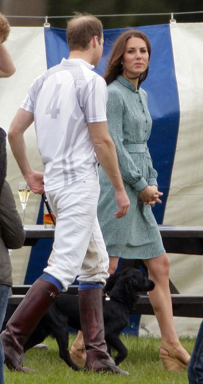 The Cambridges walk Lupo after William and Harry played a charity polo match at Coworth Park Polo Club on May 13, 2012.