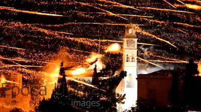 A stunning display... rockets explode on the bell tower of a Greek church. Click through to watch the video.
