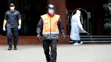 Security guards patrol the outside of Stamford Plaza on July 10, 2020 in Auckland, New Zealand.