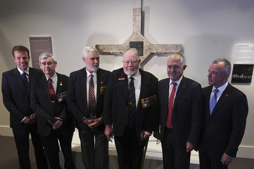 Turnbull with veterans of the Battle of Long Tan during a ceremony to commemorate the repatriation of the Long Tan Cross. (AAP)
