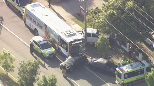 A bus has slammed into three parked cars in Brisbane.