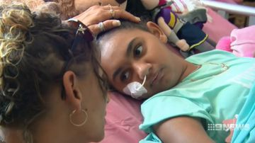Electric shock victim Denishar Woods's emotional return home