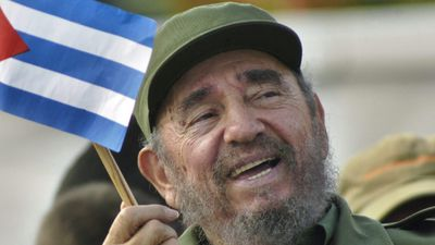 A file picture dated 01 May 2005 shows Cuban then President Fidel Castro waving a national flag during a May Day ceremony at Revolution Square in Havana, Cuba. (AAP)