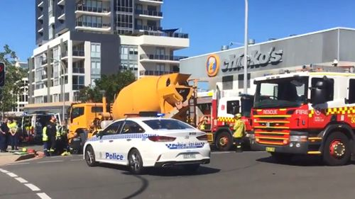 A woman was run over by a cement truck in Wollongong, south of Sydney, this morning.