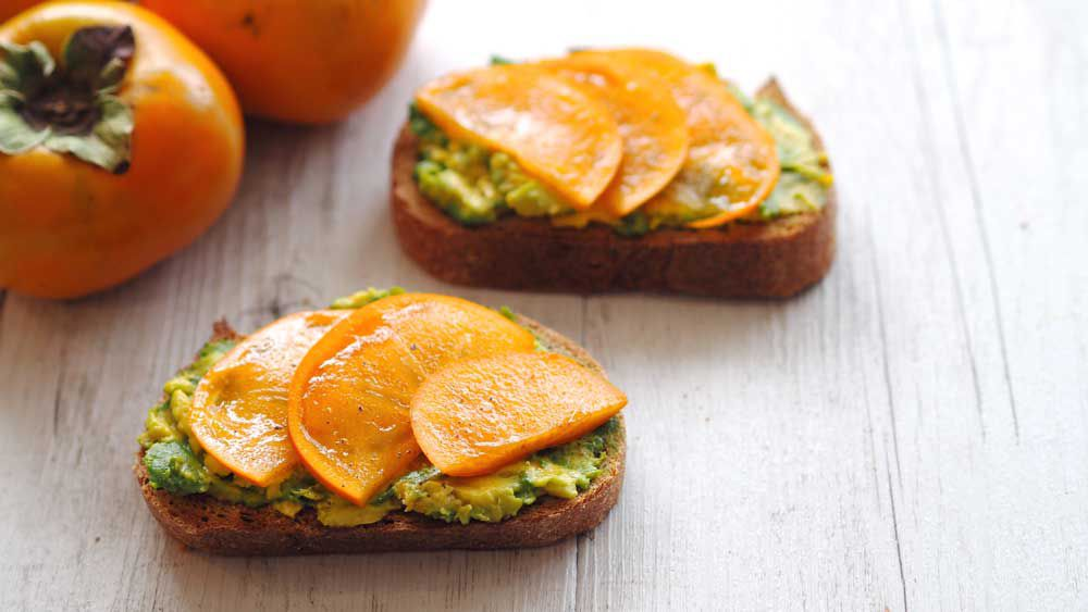 Smashed avocado with sweet persimmon