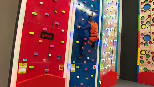 The surf house also includes Perth's first indoor adventure climbing house. (9NEWS)