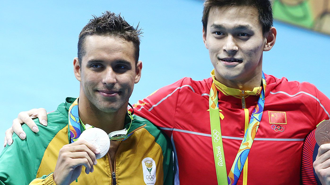 Silver medalist, South Africa's Chad Guy Bertrand le Clos, Gold medalist, China's Yang Sun at the men's 200m freestyle event at the 2016 Summer Olympic Games in Rio