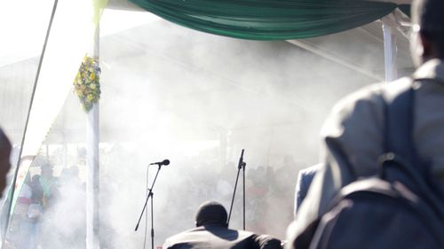 The stage filled with smoke just as the president left the stage (AAP)