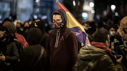 A protestor attends a march in support of imprisoned rap artist Pablo Hasel on February 21, 2021 in Barcelona, Spain. (Photo by Finbarr O'Reilly/Getty Images)