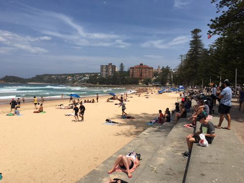 It was hard to find a vacant, shady spot at Manly Beach this afternoon. (Supplied)