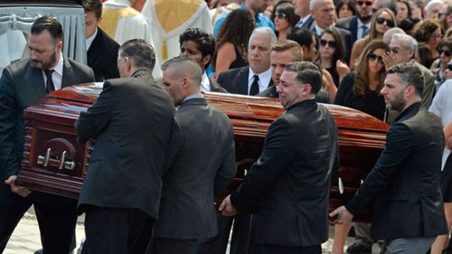 Mourners carry the casket of Karina Vetrano from St. Helen's Church following her funeral in New York.