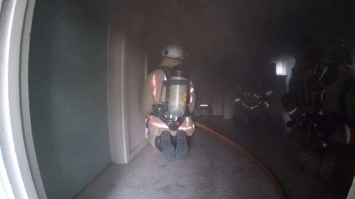 Firefighters survey the damage.