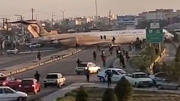 Iranian plane lands in city street